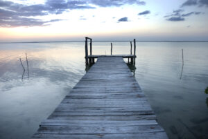 Small wooden pier on a lagoon in Sian Ka'an biosphere reserve, Quintabna Roo, Mexico